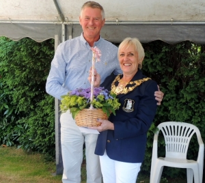 MR WBC CAPTAIN PRESENTING CC WARWICK TOWN MAYOR WITH FLOWERS AND A CHEQUE FOR HER CHOSEN CHARITY